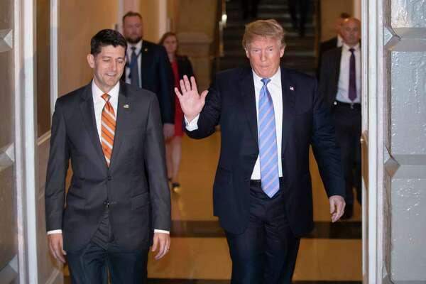 Speaker of the House Paul Ryan, R-Wis., left, walks with President Donald Trump as they head to a meeting of House Republicans to discuss a GOP immigration bill at the Capitol in Washington, Tuesday, June 19, 2018.