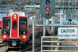 Metro-North railroad train pulls into the Union Station passenger platform Saturday morning June 8, 2013 to board passengers bound for points south to Grand Central Station in New York City. Photo by Peter Hvizdak / New Haven Register