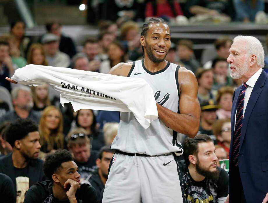 San Antonio Spurs' Kawhi Leonard jokes with head coach Gregg Popovich on the bench during first half action against the Denver Nuggets Saturday Jan. 13, 2018 at the AT&T Center. Photo: Edward A. Ornelas, San Antonio Express-News / © 2018 San Antonio Express-News