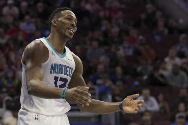 PHILADELPHIA, PA - MARCH 19: Dwight Howard #12 of the Charlotte Hornets reacts after being called for a foul in the third quarter against the Philadelphia 76ers at the Wells Fargo Center on March 19, 2018 in Philadelphia, Pennsylvania. The 76ers defeated the Hornets 108-94. (Photo by Mitchell Leff/Getty Images)