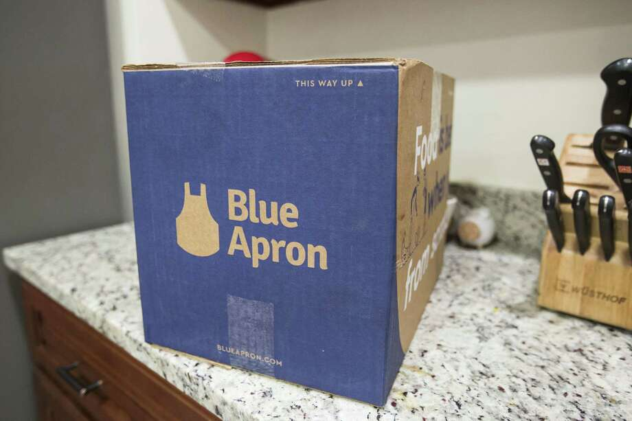 BOSTON, MA - JUNE 28: In this photo illustration, a Blue Apron box waits to be opened on a kitchen counter on June 28, 2017 in Boston, Massachusetts. The online meal-kit delivery company is going public and has lowered their upcoming IPO price range from $15 to $17 a share to $10 to $11 a share.  (Photo by Scott Eisen/Getty Images) Photo: Scott Eisen / Getty Images / 2017 Getty Images