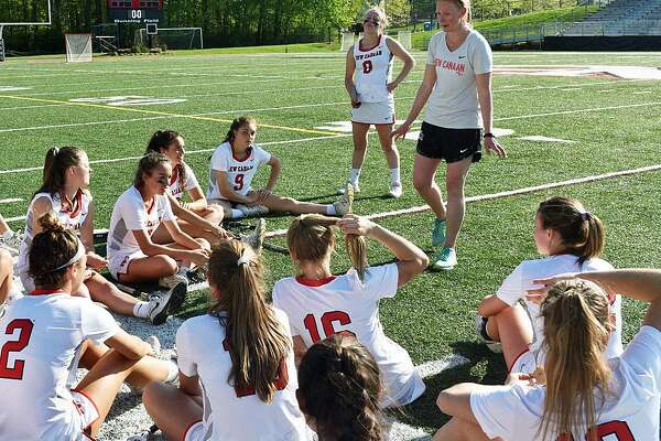 New Canaan High School girls lacrosse coach Kristin Woods talks to her team.