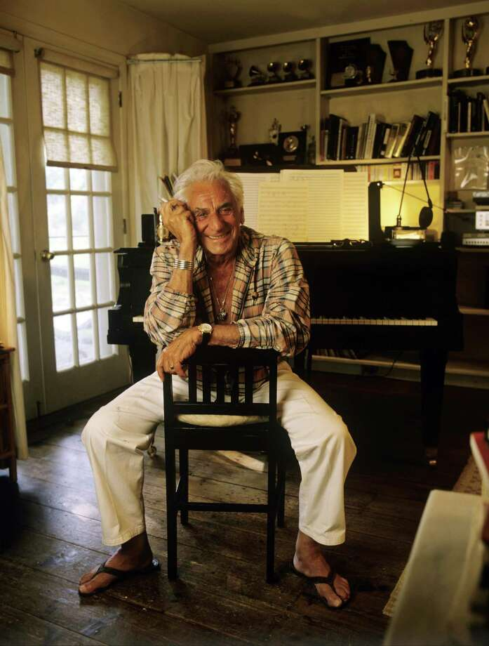 FAIRFIELD, CT - 1986:  Composer Leonard Bernstein poses near a piano in 1986 at Springate, his Fairfield, Connecticut home. Bernstein's most recognizable affiliation was as the longtime music director of the New York Philharmonic Orchestra. In addition, Bernstein was noted for writing the music for the highly acclaimed musical, West Side Story.  (Photo by Joe McNally/Getty Images) Photo: Joe McNally / Getty Images / 1986 Joe McNally