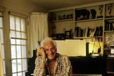 FAIRFIELD, CT - 1986:  Composer Leonard Bernstein poses near a piano in 1986 at Springate, his Fairfield, Connecticut home. Bernstein's most recognizable affiliation was as the longtime music director of the New York Philharmonic Orchestra. In addition, Bernstein was noted for writing the music for the highly acclaimed musical, West Side Story.  (Photo by Joe McNally/Getty Images)