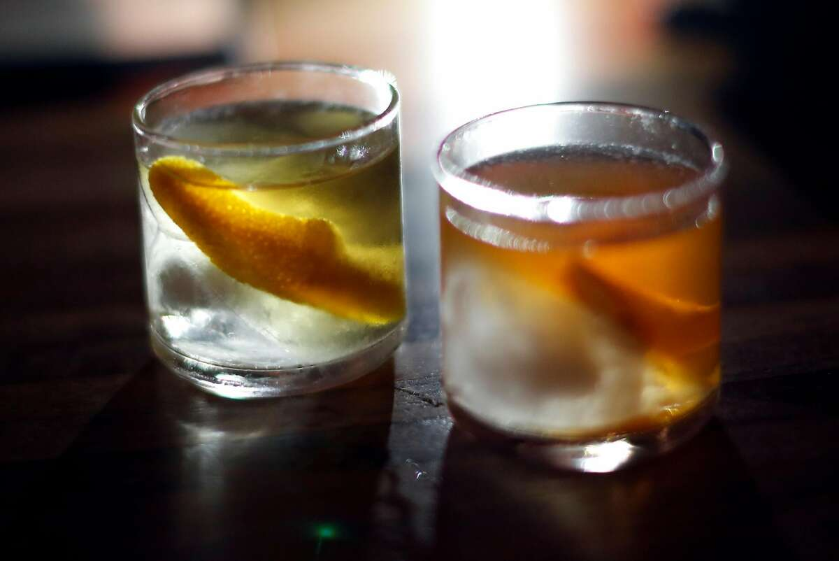 (left to right) Oaxaca Old-Fashioned and Improved Calvados Cocktail at The Interval at Long Now in San Francisco, Calif. on Tuesday, June 19, 2018.