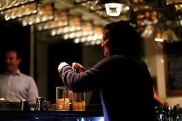 Jennifer Colliau makes an Oaxaca Old-Fashioned and an Improved Calvados Cocktail at The Interval at Long Now in San Francisco, Calif. on Tuesday, June 19, 2018.