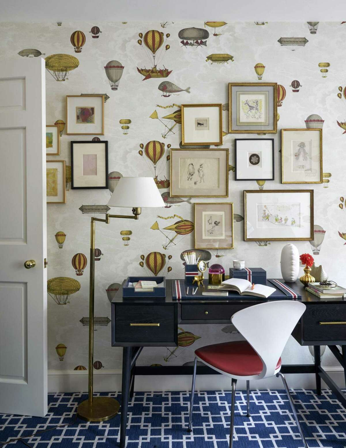 A child's room with substantial furniture and charming wallpaper was designed by Katie Lydon.