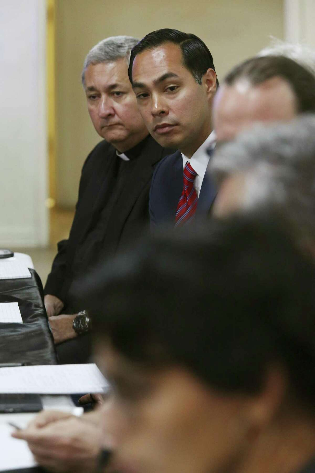 """Monsignor Bert Diaz, with St. Mary?'s Catholic Church and former Secretary of Housing and Urban Development Julian Castro participate in an immigration press briefing in Brownsville, Texas, Monday, June 18, 2018. Earlier in the day, six Democratic congress members visited two immigration shelters holding minor migrants. Some of them are the results of the President Donald Trump?'s ?""""Zero-tolerance?"""" family separation policy."""