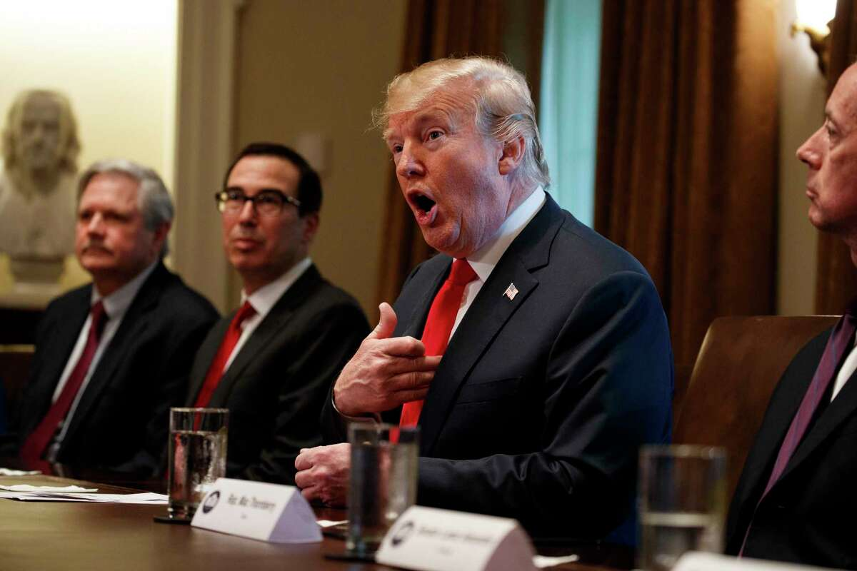 President Donald Trump speaks during a meeting with Republican members of Congress on immigration in the Cabinet Room of the White House, Wednesday, June 20, 2018, in Washington. From left, Sen. John Hoeven, R-N.D., Treasury Secretary Steve Mnuchin, Trump, and Rep. Mac Thornberry, R-Texas.
