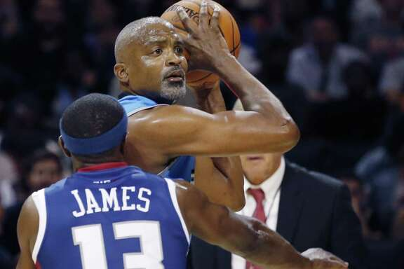 Power player/captain Cuttino Mobley, top, looks to pass as Tri-State's Mike James (13) defends during the first half of Game 2 in the BIG3 Basketball League debut, Sunday, June 25, 2017, at the Barclays Center in New York. (AP Photo/Kathy Willens)