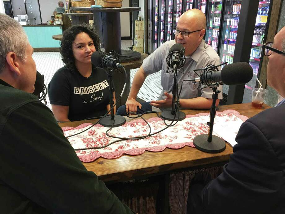 Veronica and John Avila, owners of Henderson & Kane General Store, a new neighborhood mercantile at 715 Henderson in Houston's historic Sixth Ward, talk to J.C. Reid and Greg Morago, hosts of the BBQ State of Mind podcast. Henderson & Kane will sell barbecue supplied by the Avila's El Burro & the Bull. Photo: Scott Kingsley / Houston Chronicle