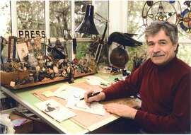 """Phil Frank, creator of the """"Farley"""" comic strip which appeared in the San Francisco Chronicle, at his home studio in Sausalito with Bruce the raven. Ran on: 09-25-2007 Park rangers listen to speakers eulogize the cartoonist, who featured Yosemite National Park prominently in his comic strip."""
