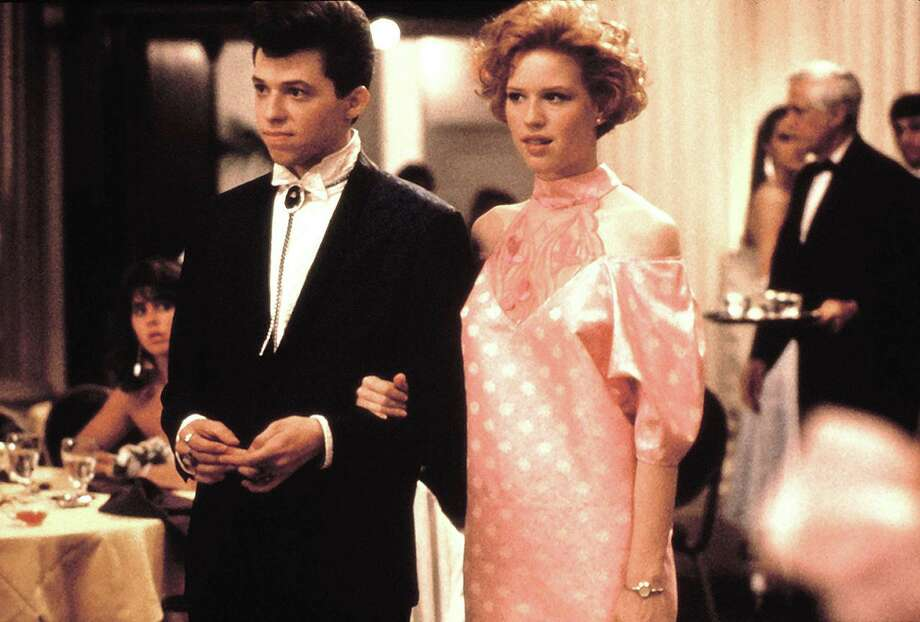 """Don't forget to dress up. Jon Cryer and Molly Ringwald in """"Pretty in Pink"""" Photo: Everett Coll / Paramount"""