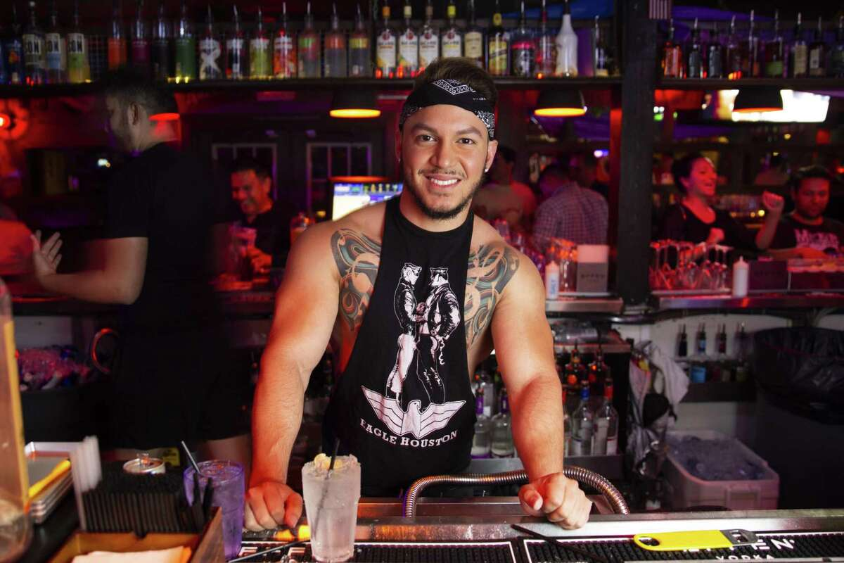 Gian Quiteno serves up drinks at The Eagle in Montrose.