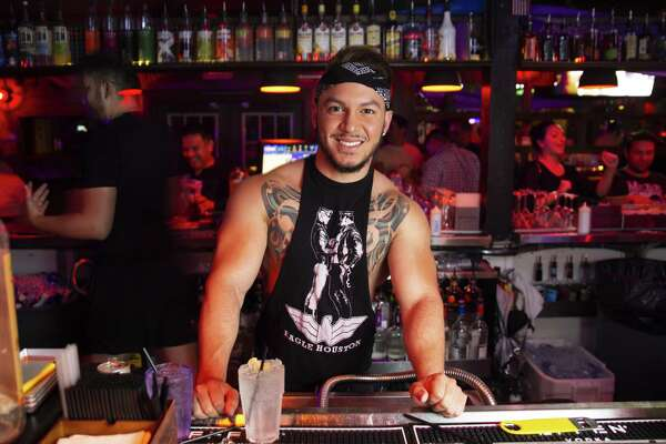 The Eagle bartender Gian Quiteno stands for a portrait.