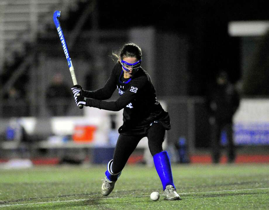 Darien's Katie Elders winds up to attempt a goal shot during CIAC Class L field hockey game last season. Photo: Christian Abraham / Hearst Connecticut Media / Connecticut Post