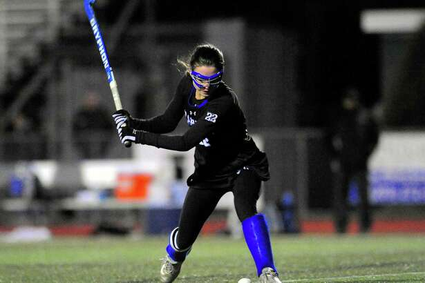 Darien's Katie Elders winds up to attempt a goal shot during CIAC Class L field hockey game last season.