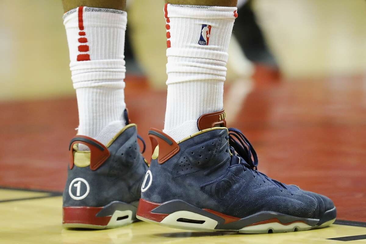 HOUSTON, TX - APRIL 3: A detailed view of the shoes worn by PJ Tucker #4 of the Houston Rockets during the game against the Washington Wizards at Toyota Center on April 3, 2018 in Houston, Texas. NOTE TO USER: User expressly acknowledges and agrees that, by downloading and or using this Photograph, user is consenting to the terms and conditions of the Getty Images License Agreement. (Photo by Tim Warner/Getty Images)