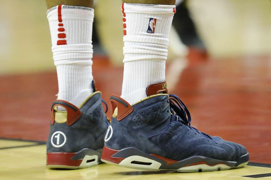 HOUSTON, TX - APRIL 3:  A detailed view of the shoes worn by PJ Tucker #4 of the Houston Rockets during the game against the Washington Wizards at Toyota Center on April 3, 2018 in Houston, Texas.  NOTE TO USER: User expressly acknowledges and agrees that, by downloading and or using this Photograph, user is consenting to the terms and conditions of the Getty Images License Agreement.  (Photo by Tim Warner/Getty Images) Photo: Tim Warner