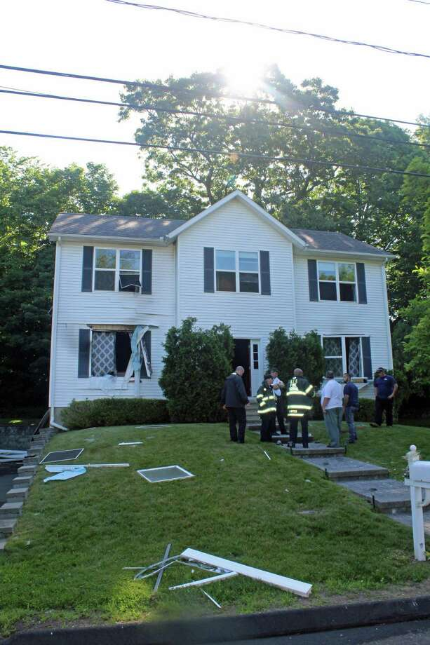 The house at 10 Deepwoods Lane in Norwalk, where a powerful propane explosion blew out windows and started a fire. Photo: Thane Grauel / Hearst Connecticut Media / Connecticut Post