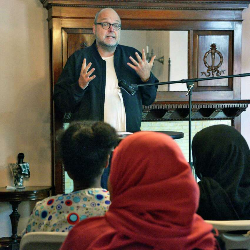 Poet and professor Mark Nowak who teaches refugees and immigrants who are learning English to write poetry in English, introduces the Women's Club of Albany's Refugees: Poetry from the Heart program Wednesday June 20, 2018 in Albany, NY. (John Carl D'Annibale/Times Union)