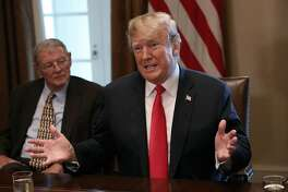 WASHINGTON, DC - JUNE 20:  U.S. President Donald Trump (R) speaks on immigration issues while meeting with members of the U.S. Congress in the Cabinet Room of the White House June 20, 2018 in Washington, DC. Trump said he would sign an executive order later today relating to the issue of immigrant children being separated from their parents while being detained. Also pictured is Sen. James Inhofe (R-OK).  (Photo by Win McNamee/Getty Images)
