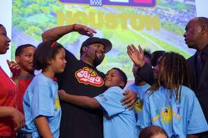 Local kids surround BIG3 co-founder Ice Cube as he talks with Houston mayor Sylvester Turner following a press conference celebrating the BIG3 basketball league's upcoming opening night this Friday in Houston during a press conference at City Hall, Wednesday, June 20, 2018 in downtown Houston. The BIG3 is a 3-on-3 basketball league that features former NBA players both playing and coaching.