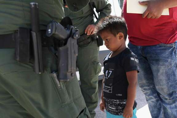 MISSION, TX - JUNE 12: A boy and father from Honduras are taken into custody by U.S. Border Patrol agents near the U.S.-Mexico Border on June 12, 2018 near Mission, Texas. The asylum seekers were then sent to a U.S. Customs and Border Protection (CBP) processing center for possible separation. U.S. border authorities are executing the Trump administration's 'zero tolerance' policy towards undocumented immigrants. U.S. Attorney General Jeff Sessions also said that domestic and gang violence in immigrants' country of origin would no longer qualify them for political asylum status.