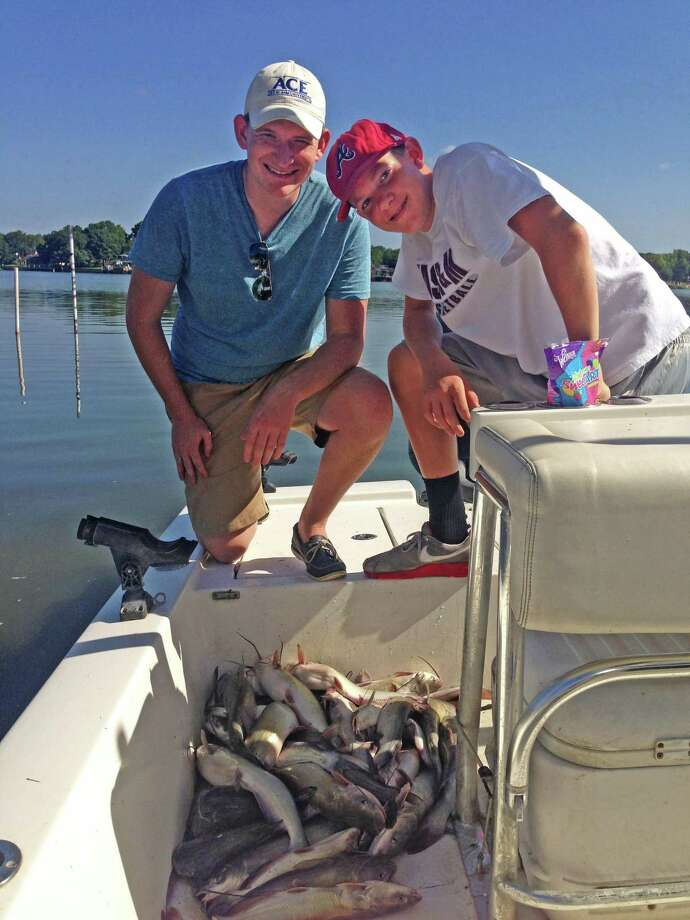 Guide Richard Tatsch took out cousins Michael Klosterboer (left) and Bryce Klosterboer (right) recently who returned with a good catch of catfish. Photo: Larry J. LeBlanc
