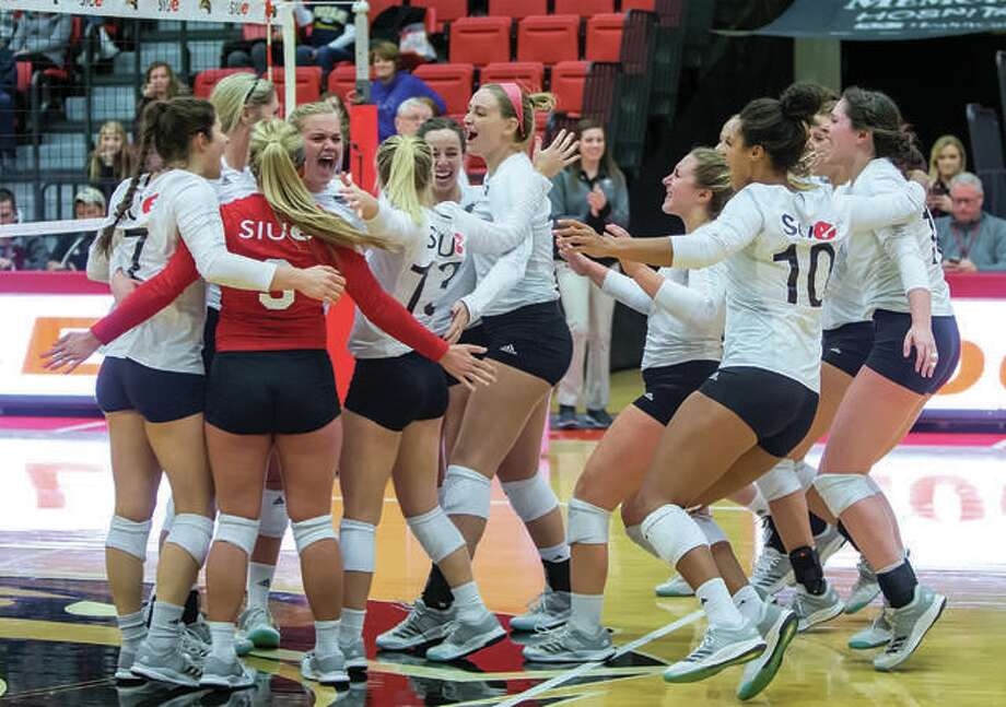 SIUE's volleyball team will play in four tournaments next season before beginning the Ohio Valley Conference portion of the campaign. The schedule was announced Wednesday. Above, players from the bench rush onto the court to join their teammates after the final point in a 15-13 fifth set that gave SIUE an Ohio Valley Conference volleyball victory over Murray State last season. Photo:       SIUE Athletics