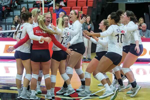 SIUE's volleyball team will play in four tournaments next season before beginning the Ohio Valley Conference portion of the campaign. The schedule was announced Wednesday. Above, players from the bench rush onto the court to join their teammates after the final point in a 15-13 fifth set that gave SIUE an Ohio Valley Conference volleyball victory over Murray State last season.