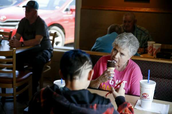 Evelyn Maddox, right, enjoys a dip cone at lunch with her grandson, Bradyn Lowery, 13, at Texas' oldest operating Dairy Queen, located in Henderson.