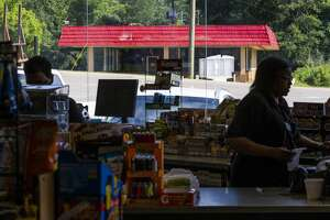 San Augustine's Dairy Queen, which closed last October, is seen through the window of the R&D convenience store in San Augustine. Some people in town blame the influx of other fast food chains for the demise of the Dairy Queen.