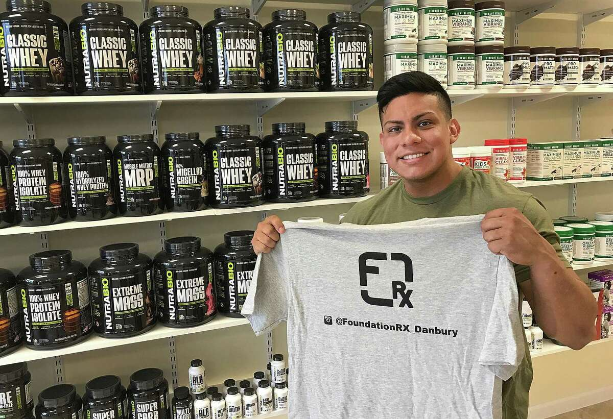 Erik Padilla of Foundation Rx stands in his vitamin and nutrition store in Brookfield, Conn., on Tuesday, June 12, 2018.