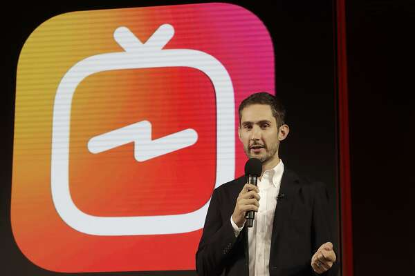 In this Tuesday, June 19, 2018, photo Kevin Systrom, CEO and co-founder of Instagram, prepares for Wednesday's announcement about IGTV in San Francisco. Facebook's Instagram app is loosening its restraints on video with a new channel that will attempt to lure younger viewers away from Google's YouTube and pave the way to sell more advertising. (AP Photo/Jeff Chiu)