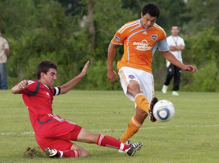 The Dynamo/Dash youth soccer club is embroiled in a controversy over soccer field access in The Woodlands. Township officials expect a large crowd of interested people at the June 27 meeting of The Woodlands Township Board of Directors, when the issue is expected to be discussed. This is a 2010 file image of the Houston Dynamo U-17 soccer team facing off against other elite youth teams.