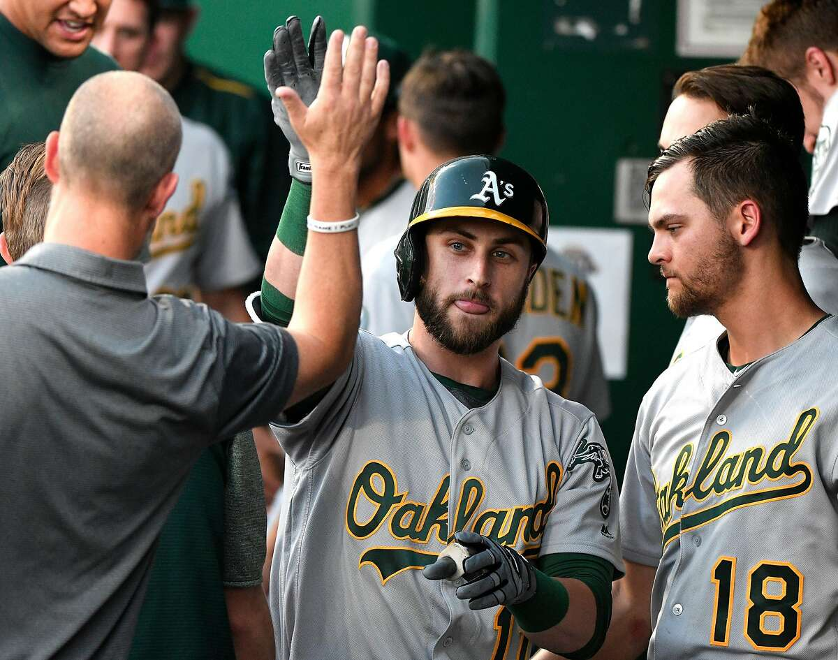 KANSAS CITY, MO - JUNE 1: Dustin Fowler #11 of the Oakland Athletics celebrates his home run with teammates in the third inning against the Kansas City Royals at Kauffman Stadium on June 1, 2018 in Kansas City, Missouri. (Photo by Ed Zurga/Getty Images)