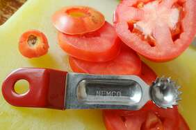 A tomato corer is a handy tool to have around the kitchen when you have a large quantity of tomatoes to cut.