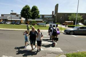 Students are dismissed from Stratford Academy Johnson House on Birdseye Street in Stratford, Conn., on Tuesday June 12, 2018.