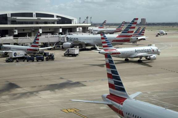 In this June 16, 2018 photo, American Airlines aircrafts are seen at Dallas-Fort Worth International Airport in Grapevine, Texas. American Airlines says it asked the Trump administration not to put migrant children who have been separated from their parents on its flights. In a statement Wednesday, June 20, American said it doesn't know whether any migrant children have been on its flights and doesn't want to profit from the current immigration policy of separating families.