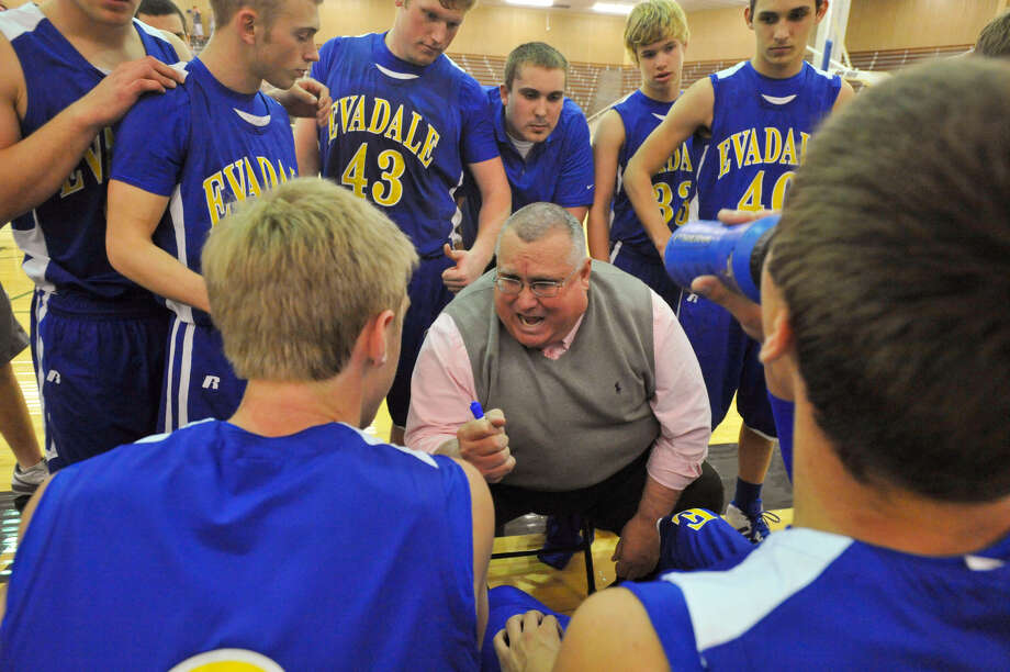 Evadale head basketball coach Laurence Williams takes a time out with his players in the second half against the Stacey Eagles in the 1A Division I Region IV final at the Burger Athletic Center in Austin. March 5, 2011.  Valentino Mauricio/The Enterprise