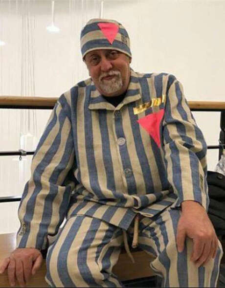 Gilbert Baker wears one of his concentration camp uniforms in 2017. It is thought to be one of the last costumes he created before his death.