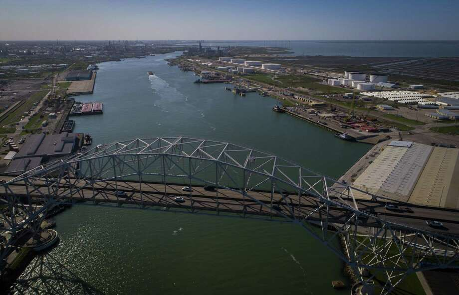 The Harbor Bridge crosses over the entrance to what is known as Refinery Row in Corpus Christi. Multiple refineries call the port home, as do crude oil and refined product loading docks. The bridge is being replaced be a taller structure to allow larger ships to enter. Photo: Mark Mulligan /Houston Chronicle / © 2018 Houston Chronicle