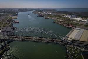 The Harbor Bridge crosses over the entrance to what is known as Refinery Row in Corpus Christi. Multiple refineries call the port home, as do crude oil and refined product loading docks. The bridge is being replaced be a taller structure to allow larger ships to enter.