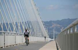 Cyclists cross the bike path on the Bay Bridge from Oakland to Treasure Island.