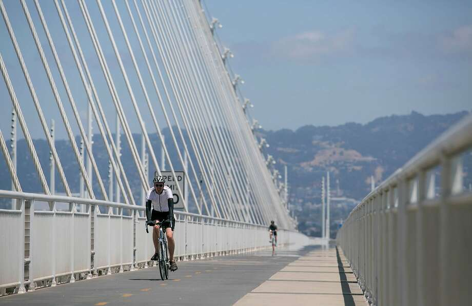 Cyclists cross the bike path on the Bay Bridge from Oakland to Treasure Island. The next goal is to extend it to San Francisco. Photo: Brian Feulner / Special To The Chronicle