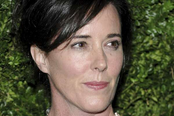 FILE - In this Nov. 17, 2008 file photo, designer Kate Spade attends the CFDA/Vogue Fashion Fund finalists event in New York.  Kate Spade New York has announced plans to donate $1 million to support suicide prevention and mental health awareness causes in tribute to the company's late founder. The 55-year-old fashion designer killed herself June 5, 2018. Her husband says she suffered from depression and anxiety for many years. (AP Photo/Evan Agostini,)