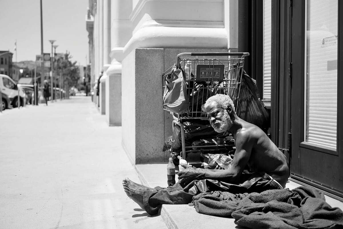 Jerry Womack, who has been homeless for 8 years, sits in a doorway on Van Ness Street near Market in San Francisco, Calif., on Thursday May 31, 2018.