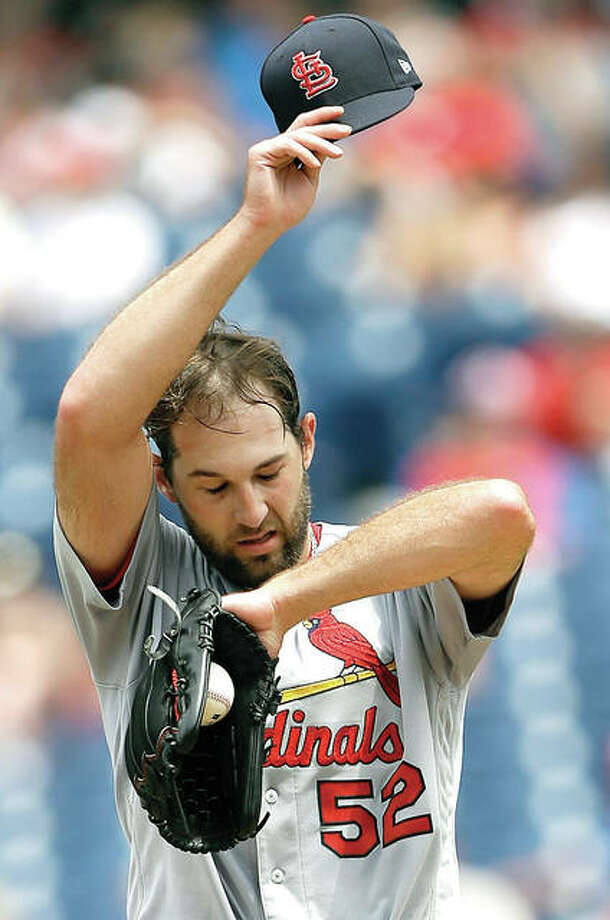 Cardinals pitcher Michael Wacha wipes sweat from his brow during Wednesday game in Philadelphia. Wacha later left the game with a strained oblique muscle. Photo:       AP