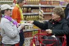 FILE — Customers get samples in the new Trader Joe's during their grand opening on High Ridge Road in Stamford, Conn., on Thursday, October 31, 2013.